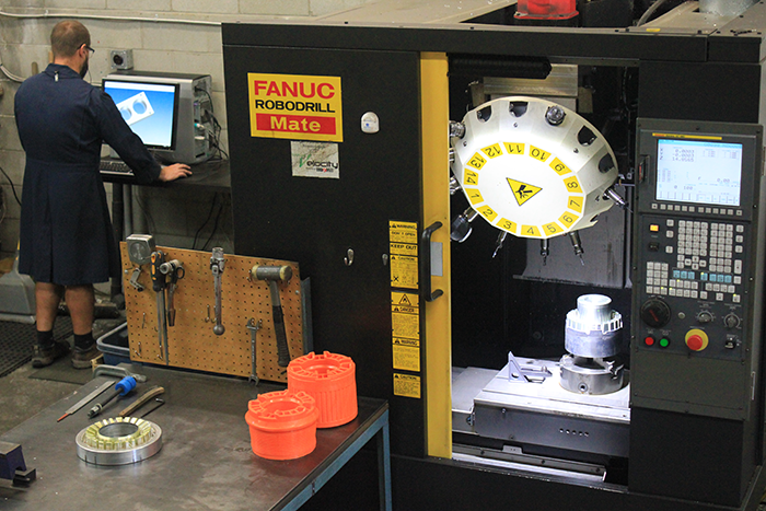 Senior tool-maker designing a new mold in our machine shop