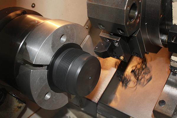 CNC lathe machining a precision Thread Protector